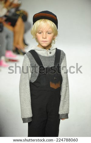 NEW YORK, NY - OCTOBER 18: A model walks the runway during the Parsons preview at petitePARADE / Kids Fashion Week at Bathhouse Studios on October 18, 2014 in New York City.  - stock photo