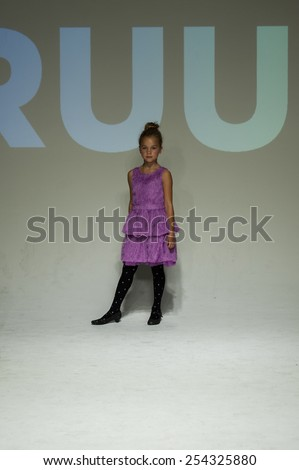 NEW YORK, NY - OCTOBER 19: A model walks the runway during the Ruum preview at petitePARADE / Kids Fashion Week at Bathhouse Studios on October 19, 2014 in New York City.