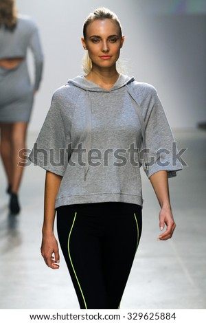 NEW YORK, NY - OCTOBER 14: A model walks the runway during 2(X)IST Men's Spring/Summer 2016 Runway Show at Skyline Modern on October 14, 2015 in NYC.