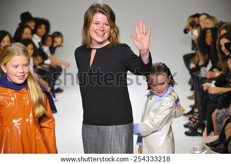 NEW YORK, NY - OCTOBER 18: Designer Amy Wismar walks the runway with models during the Oil & Water preview at petitePARADE / Kids Fashion Week on October 18, 2014 in New York City. - stock photo