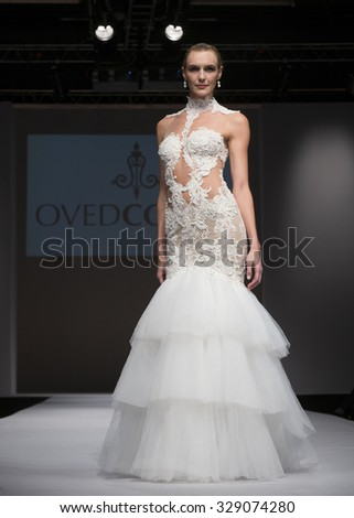 New York, NY - October 11, 2015: Model walks runway for Bridal COuture from Israel by Oved Cohen during New York bridal week at Pier 94 - stock photo