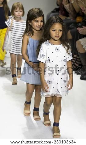 NEW YORK, NY - OCTOBER 18, 2014: Models walk the runway during the Chloe preview at petitePARADE - Kids Fashion Week at Bathhouse Studios - stock photo