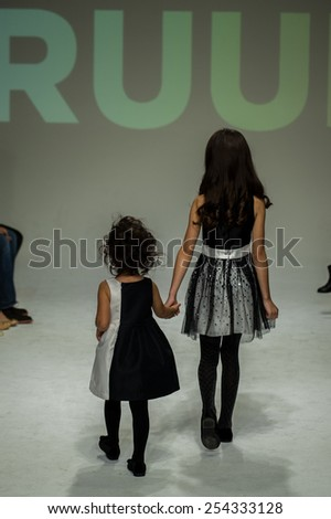 NEW YORK, NY - OCTOBER 19: Models walk the runway during the Ruum preview at petitePARADE / Kids Fashion Week at Bathhouse Studios on October 19, 2014 in New York City. - stock photo