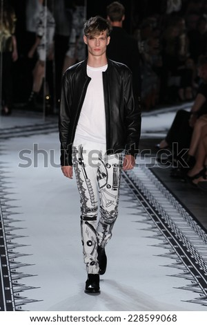 NEW YORK, NY - SEPTEMBER 07: A male model walks the runway at the Versus Versace Spring 2015 Collection during Mercedes-Benz Fashion Week at Metropolitan West on September 7, 2014 in NYC. - stock photo