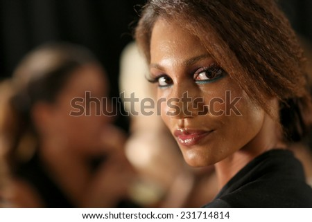 NEW YORK, NY - SEPTEMBER 06: A model poses backstage at Venexiana during Mercedes-Benz Fashion Week Spring 2015 at Lincoln Center on September 6, 2014 in NYC - stock photo