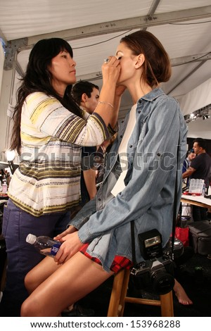 NEW YORK, NY - SEPTEMBER 07: A model prepares backstage at the Katya Leonovich show during Spring 2014 Mercedes-Benz Fashion Week at The Studio at Lincoln Center on September 7, 2013 in New York City.