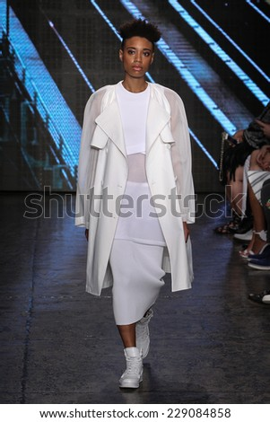 NEW YORK, NY - SEPTEMBER 07: A model walks the runway at DKNY during Mercedes-Benz Fashion Week Spring 2015 at 547 West 26th Street on September 7, 2014 in NYC. - stock photo
