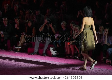 NEW YORK, NY - SEPTEMBER 11: A model walks the runway at Marc Jacobs during Mercedes-Benz Fashion Week Spring 2015 at Seventh Regiment Armory on September 11, 2014 in NYC. - stock photo