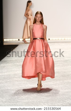 NEW YORK, NY - SEPTEMBER 05: A model walks the runway at Monique Lhuillier during Mercedes-Benz Fashion Week Spring 2015 on September 5, 2014 in New York City.  - stock photo