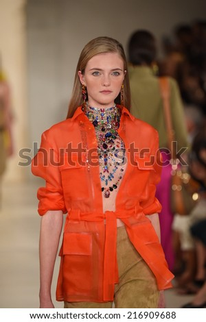 NEW YORK, NY - SEPTEMBER 11: A model walks the runway at Ralph Lauren fashion show during Mercedes-Benz Fashion Week Spring 2015 on September 11, 2014 in New York City. - stock photo
