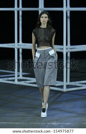 NEW YORK, NY - SEPTEMBER 07: A model walks the runway at the Alexander Wang Spring 2014 fashion show during Mercedes-Benz Fashion Week at Pier 94 in New York City on September 7, 2013 .