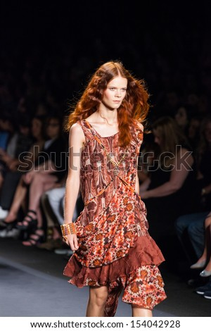 NEW YORK, NY - SEPTEMBER 11: A model walks the runway at the Anna Sui Spring Summer 2014 fashion show during Mercedes-Benz Fashion Week on September 11, 2013 in New York City, USA.