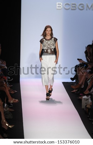 NEW YORK, NY - SEPTEMBER 05: A model walks the runway at the BCBGMAXAZRIA show during Spring 2014 Mercedes-Benz Fashion Week at The Theatre at Lincoln Center on September 5, 2013 in New York City.