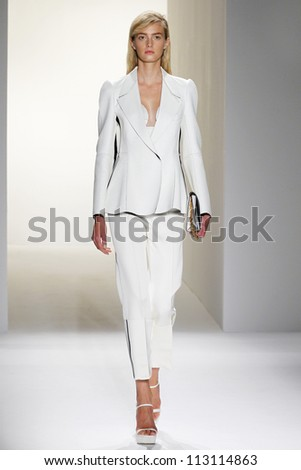 NEW YORK, NY - SEPTEMBER 13: A model walks the runway at the Calvin Klein Spring Summer 2013 collection presentation during Mercedes Benz Fashion Week on September 13, 2012 in New York City, USA
