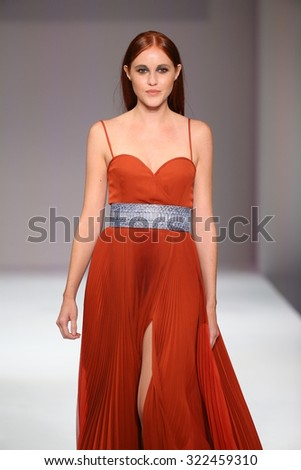 NEW YORK, NY - SEPTEMBER 11: A model walks the runway at the Esosa fashion show during Spring 2016 New York Fashion Week at Gotham Hall on September 11, 2015 in New York City. - stock photo