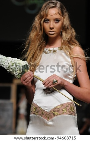 NEW YORK, NY - SEPTEMBER 15: A model walks the runway at the GULI Spring/Summer 2012 Collection at Cipriani 42nd Street on September 15, 2011 in New York City.