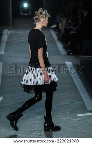 NEW YORK, NY - SEPTEMBER 09: A model walks the runway at the Marc By Marc Jacobs fashion show during Mercedes-Benz Fashion Week Spring 2015 at Pier 94 on September 9, 2014 in New York City. - stock photo