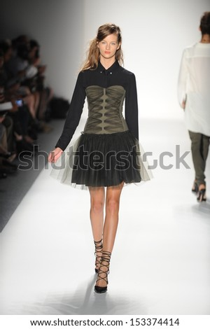 NEW YORK, NY - SEPTEMBER 05: A model walks the runway at the Marissa Webb Spring 2014 fashion show during Mercedes-Benz Fashion Week at Lincoln Center on September 5, 2013 in New York City. - stock photo