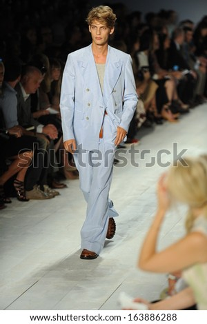 NEW YORK, NY - SEPTEMBER 11: A model walks the runway at the Michael Kors show during Spring 2014 Mercedes-Benz Fashion Week at The Theatre at Lincoln Center on September 11, 2013 in New York City.