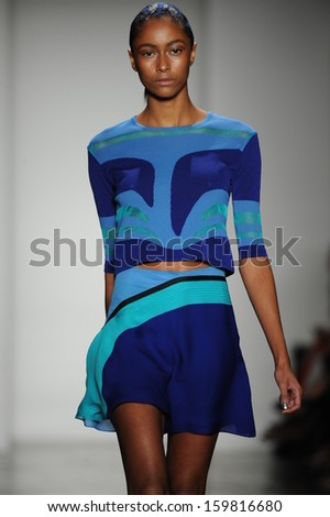 NEW YORK, NY - SEPTEMBER 09: A model walks the runway at the Ohne Titel show during Spring 2014 Mercedes-Benz Fashion Week at Milk Studios on September 9, 2013 in New York City. - stock photo