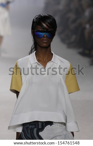 NEW YORK, NY - SEPTEMBER 09: A model walks the runway at the 3.1 Phillip Lim show during Spring 2014 Mercedes-Benz Fashion Week on September 9, 2013 in New York City.