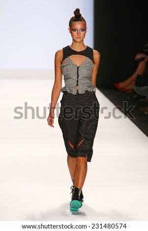 NEW YORK, NY - SEPTEMBER 05: A model walks the runway at the Project Runway (Emily Payne) show during MBFW Spring 2015 at Lincoln Center on September 5, 2014 in NYC - stock photo