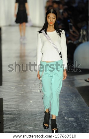 NEW YORK, NY - SEPTEMBER 06: A model walks the runway at the Rag & Bone Women's Collection show during Spring 2014 Mercedes-Benz Fashion Week on September 6, 2013 in New York City.