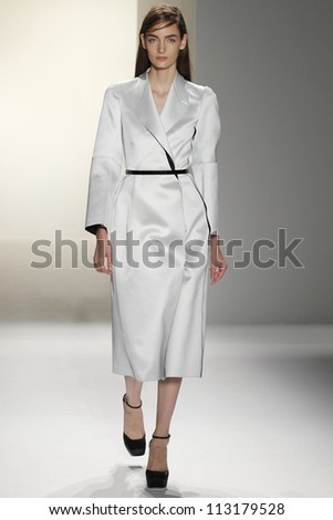 NEW YORK, NY - SEPTEMBER 13: A model walks the runway during Calvin Klein Spring Summer 2013 collection presentation during Mercedes Benz Fashion Week on September 13, 2012 in New York City, USA