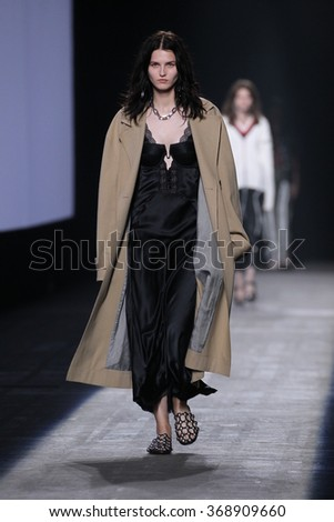 NEW YORK, NY - SEPTEMBER 12: A model walks the runway during the Alexander Wang Spring/Summer 2016 fashion show at Pier 94 on September 12, 2015 in NYC - stock photo