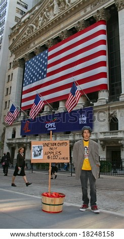 NEW YORK, NY -- SEPTEMBER 30, 2008: A poor boy outside the New York Stock Exchange on September 30, 2008, the day after the record-breaking 777-point drop in the Dow