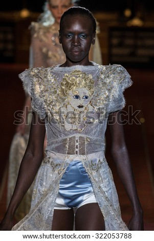 NEW YORK, NY - SEPTEMBER 17: Alek Wek walks the runway during the Marc Jacobs show during Spring 2016 New York Fashion Week: The Shows at Ziegfeld Theater on September 17, 2015 in New York City. - stock photo
