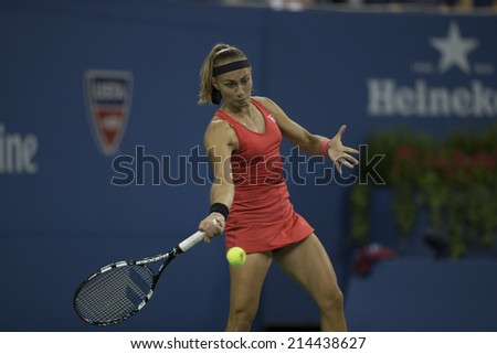 NEW YORK, NY - SEPTEMBER 1, 2014: Aleksandra Krunic of Serbia returns ball during 4th round match against Victoria Azarenka of Belarus at US Open championship in Flushing Meadows USTA Tennis Center