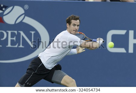New York, NY - September 7, 2015: Andy Murray of Great Britain returns ball during 4th round match against Kevin Andreson of South Africa at US Open Championship - stock photo