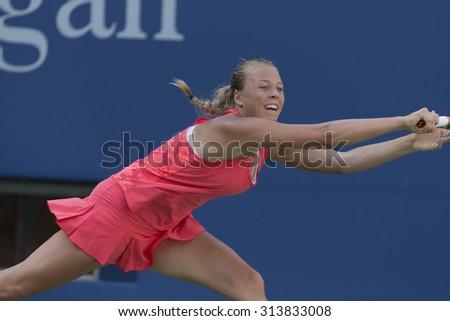 New York, NY - September 6, 2015: Anett Kontaveit of Estonia returns ball during 4th round against Venus Williams of USA at US Open Championship - stock photo