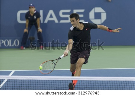New York, NY - September 3, 2015: Bernard Tomic of Australia returns ball during 2nd round match against Lleyton Hewitt of Australia at US Open championship