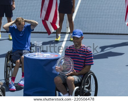 NEW YORK, NY - SEPTEMBER 7, 2014: David Wagner of USA with runner-up trophy of wheelchair Quad Singles final against Andrew Lapthorne of UK at US Open championship in Flushing Meadows USTA Center - stock photo