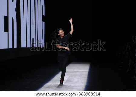 NEW YORK, NY - SEPTEMBER 12: Designer Alexander Wang walks the runway during the Alexander Wang Spring/Summer 2016 fashion show at Pier 94 on September 12, 2015 in NYC - stock photo