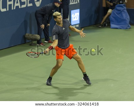 New York, NY - September 5, 2015: Dominic Thiem of Austria returns ball during 3rd round match against Kevin Anderson of South Africa at US Open Championship - stock photo