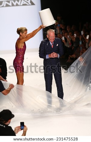 NEW YORK, NY - SEPTEMBER 05: Heidi Klum pours ice on Tim Gunn for the ALS Ice Bucket Challenge during the Project Runway Season 13 Finale Show during MBFW Spring 2015 on September 5, 2014 in NYC - stock photo