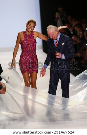 NEW YORK, NY - SEPTEMBER 05: Heidi Klum smiles at audience with Tim Gunn after ALS Ice Bucket Challenge at Project Runway during MBFW Spring 2015  on September 5, 2014 in NYC - stock photo