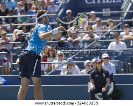 New York, NY - September 5, 2015: Jiri Vesely of Czech Republic returns ball during 3rd round match against John Isner of USA at US Open Championship - stock photo
