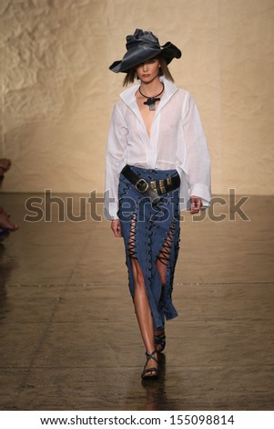 NEW YORK, NY - SEPTEMBER 09: Karlie Kloss walks the runway at the Donna Karan New York fashion show during Mercedes-Benz Fashion Week Spring 2014 on September 9, 2013 in New York City. - stock photo