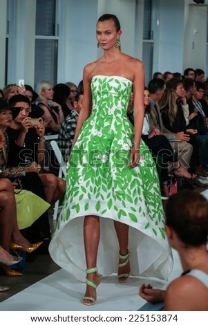 NEW YORK, NY - SEPTEMBER 09:  Karlie Kloss walks the runway at the Oscar De La Renta fashion show during Mercedes-Benz Fashion Week Spring 2015 on September 9, 2014 in New York City. - stock photo