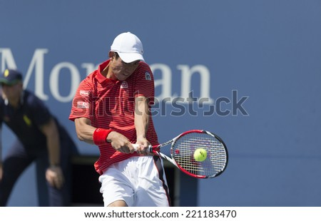 NEW YORK, NY - SEPTEMBER 6, 2014: Kei Nishikori of Japan returns ball during semifinal match against Novak Djokovic of Serbia at US Open championship in Flushing Meadows USTA Tennis Center - stock photo