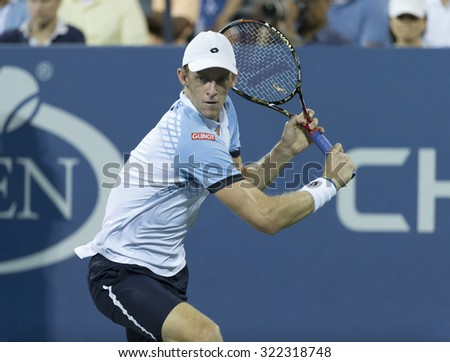 New York, NY - September 9, 2015: Kevin Anderson of South Africa returns ball during quarterfinal against Stan Wawrinka of Switzerland at US Open Championship - stock photo
