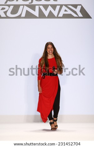 NEW YORK, NY - SEPTEMBER 05: Korina Emmerich walks the runway at the Project Runway show during MBFW Spring 2015 at Lincoln Center on September 5, 2014 in NYC - stock photo