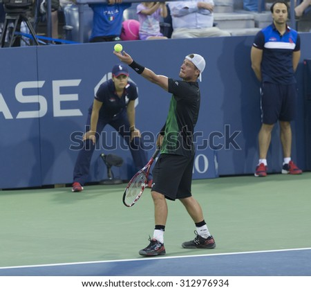 New York, NY - September 3, 2015: Lleyton Hewitt of Australia serves ball during 2nd round match against Bernard Tomic of Australia at US Open championship - stock photo