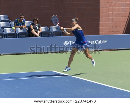 NEW YORK, NY - SEPTEMBER 7, 2014: Marie Bouzkova of Czech Republic returns ball during final girls juniors match against Anhelina Kalinina of Ukraine at US Open championship in Flushing Meadows - stock photo