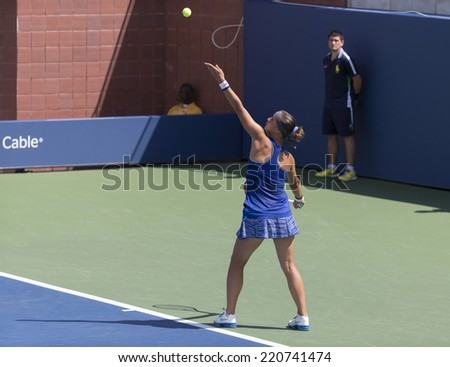 NEW YORK, NY - SEPTEMBER 7, 2014: Marie Bouzkova of Czech Republic serves ball during final girls juniors match against Anhelina Kalinina of Ukraine at US Open championship in Flushing Meadows - stock photo