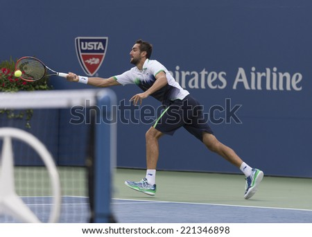 NEW YORK, NY - SEPTEMBER 6, 2014: Marin Cilic of Croatia returns ball during semifinal match against Roger Federer of Switzerland at US Open championship in Flushing Meadows USTA Tennis Center - stock photo